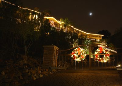 Two Lit and Decorated Gate Wreaths