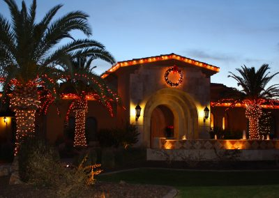 Holiday Lit Front Entrance and Palm Trees