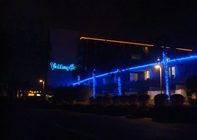 Hotel Holiday Lighting and Wrapped Palm Trees in Blue